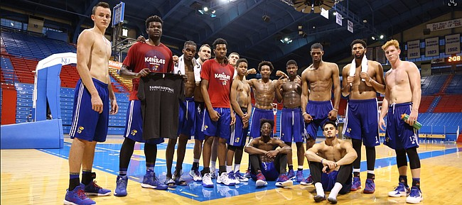 The 2017-18 Kansas men's basketball team poses for a photo inside Allen Fieldhouse to mark the end of Boot Camp 2017 on Wednesday, Sept. 27, 2017.