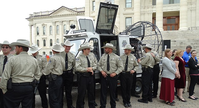 Kansas Department of Wildlife, Parks and Tourism officers who performed water rescue services in Texas following Hurricane Harvey are honored at a Statehouse ceremony Wednesday. The fan-driven pontoon boat they used is frequently used for water rescues on the Kansas River.