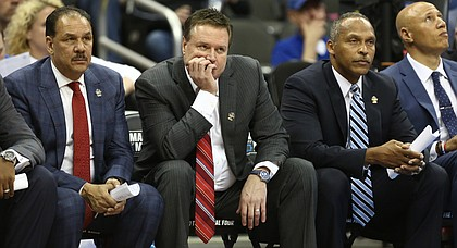 Kansas head coach Bill Self and his staff watch from the bench late during the second half on Saturday, March 25, 2017 at Sprint Center.