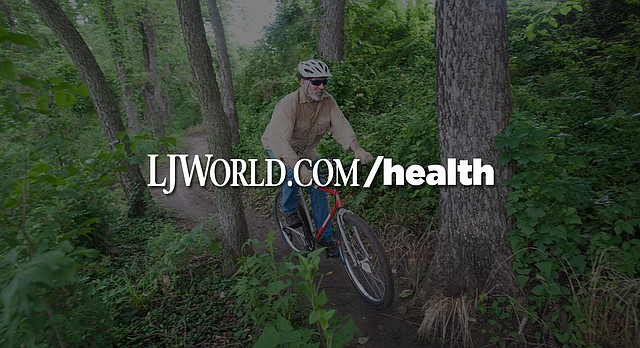 In this file photo from June 6, 2015, Art King, a member of the Lawrence Mountain Bike Club and one of the leaders who helps maintain the 10.5 mile trail that snakes through the woods and hills along the north bank of the Kansas River, leads a ride through the popular terrain.
