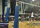 A referee observes No. 11 Kansas volleyball's sweep over TCU from the padded stand alongside the net.