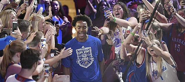 Kansas senior guard Devonte' Graham walks down the aisle during his team's introductions in the 33rd-annual Late Night in the Phog on Saturday, Sept. 30, 2017 at Allen Fieldhouse.