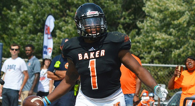 Baker freshman JD Woods looks over to the sidelines after scoring a touchdown in the Wildcats' 66-14 win over Graceland on Sept. 16 at Liston Stadium.