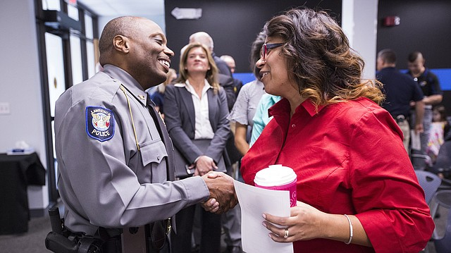 Lawrence police chief Gregory Burns Jr. receives a warm welcome from Jessica Lemons, an administrative assistant in the investigations department with LPD, following his swearing in ceremony on Monday, Oct. 2, 2017 at the Lawrence Police Department Investigations Center, 4820 Bob Billings Parkway. Burns formerly served as the assistant police chief in the Louisville, Ky., Metro Police Department.