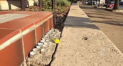 A group of candles is placed on a wall at the northwest corner of 11th and Massachusetts streets in Lawrence, pictured Monday, Oct. 2, 2017. The intersection was the site of a shooting that killed three people and wounded two others early the previous morning.