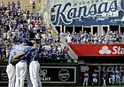 Veteran Kansas City Royals players Eric Hosmer, Lorenzo Cain, Mike Moustakas and Alcides Escobar gather in the infield before coming out of the game during the fifth inning of a baseball game against the Arizona Diamondbacks Sunday in Kansas City, Mo.