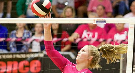 Lawrence High junior Baylee Unruh taps the ball over the net against Free State in Tuesday's triangular at LHS.