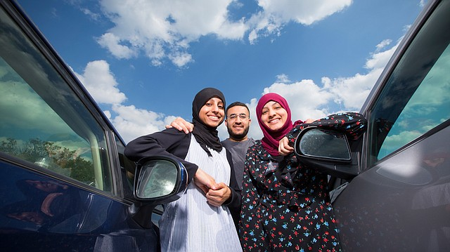 With lessons from their older brother Hassan Al Ghafli, Lawrence sisters Ghufran, left, and Bayan Al Ghafli recently began learning to drive, something that women have been prohibited from doing in Saudi Arabia, their native country. The ban on female drivers is set to be lifted next summer.