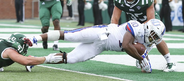 Kansas running back Khalil Herbert (10) falls into the end zone for a touchdown to end the game on Saturday, Sept. 16, 2017 at Peden Stadium in Athens, Ohio.