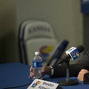 Kansas women's basketball coach Brandon Schneider talks with media members during Media Day on Wednesday, Oct. 4, 2017 at Allen Fieldhouse.