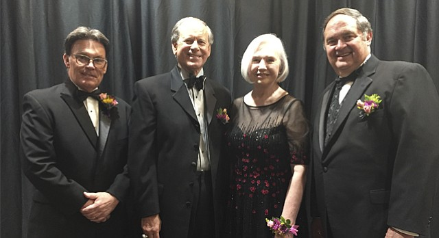 The 2017 inductees to the Lawrence Business Hall of Fame — from left, Mike Amyx, Miles Schnaer, Jean Milstead and Larry McElwain — are pictured Wednesday at the induction ceremony at the DoubleTree Hotel.