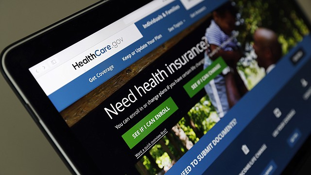 "In this May 18, 2017 file photo, the Healthcare.gov website is seen on a laptop computer in Washington. Former Obama administration officials say they're launching a private campaign to encourage people to sign up for coverage next year under the Affordable Care Act. With the start of open enrollment just weeks away on Nov. 1, the Trump administration has slashed ""Obamacare's"" ad budget, as well as grants to outside organizations that are supposed to help consumers sign up. (AP Photo/Alex Brandon, File)"