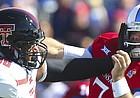 Texas Tech defensive lineman Nick McCann (98) gives a slap to Kansas quarterback Peyton Bender (7) after a pass during the first quarter on Saturday, Oct. 7, 2017 at Memorial Stadium.