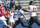 Kansas quarterback Carter Stanley (9) can't stop Texas Tech defensive back Justus Parker (31) as he runs into the end zone for a touchdown during the third quarter after an interception on Saturday, Oct. 7, 2017 at Memorial Stadium.