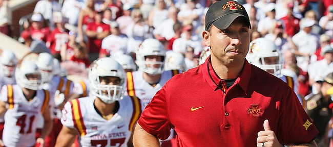Second-year Iowa State head coach Matt Campbell leads his Cyclones onto the field in Norman, Oklahoma, Saturday before they upset No. 3 Oklahoma, 38-31. (Associated Press photo.)
