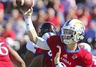 Kansas quarterback Carter Stanley (9) throws a pass during the first quarter on Saturday, Oct. 7, 2017 at Memorial Stadium.