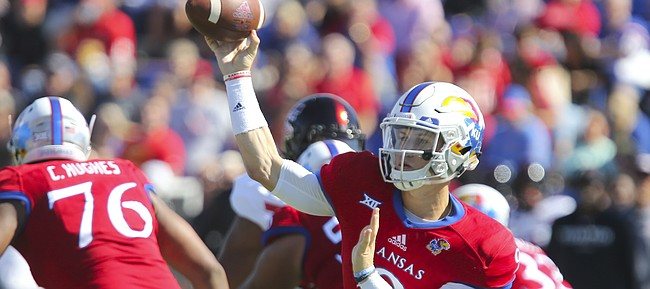 Kansas quarterback Carter Stanley (9) throws a pass during the first quarter on Saturday, Oct. 7, 2017 at Memorial Stadium.