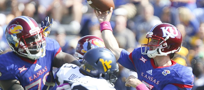 Kansas quarterback Peyton Bender (7) throws during the second quarter on Saturday, Sept. 23, 2017 at Memorial Stadium.