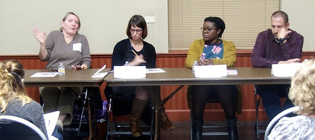 Gretchen Lister, left, answers a question Tuesday at a forum for candidates for three Lawrence school board position on the Nov. 7 ballot, while, from the left, Kelly Jones, Melissa Johnson and G.R. Gordon-Ross listen. Candidate James Hollinger was unable to attend the forum at the Union Pacific Depot because of illness.
