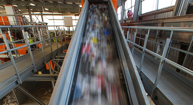 Recycling materials are pulled up a conveyor to be sent through a complex sorting system on Wednesday, Feb. 17, 2016 at the Hamm's Recycling Facility, 26195 Linwood Road, that processes Lawrence's recyclable materials.