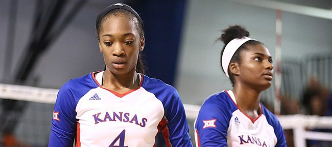 Kansas outside hitter Jada Burse (4) and Kansas right side hitter Kelsie Payne (8) show their frustration as Texas widens its lead in the fourth set on Wednesday, Oct. 11, 2017 at Horejsi Center.