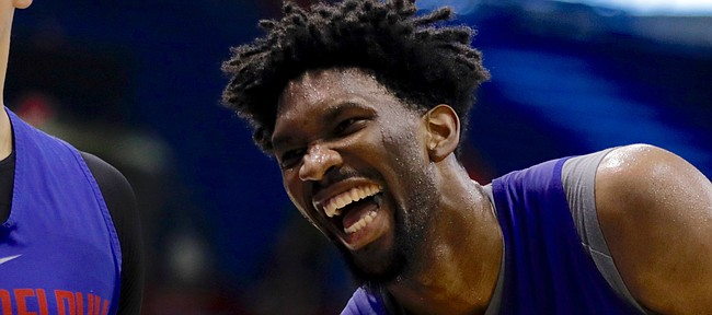 Former Kansas center Joel Embiid laughs while working with Philadelphia teammate Dario Saric in Allen Fieldhouse on Thursday, Oct. 12, 2017, during a Sixers practice.