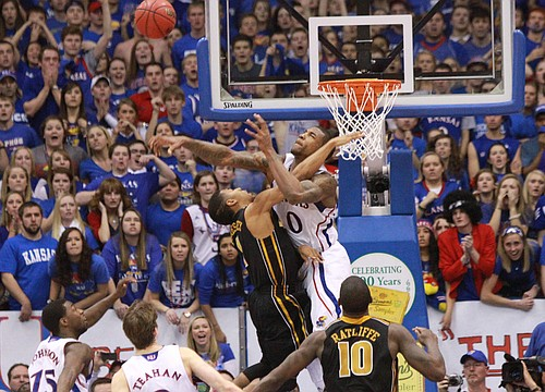 Kansas forward Thomas Robinson blocks a shot by Missouri guard Phil Pressey to take the game into overtime, Saturday, Feb. 25, 2012, at Allen Fieldhouse.
