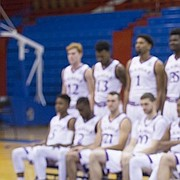 Kansas head coach Bill Self watches off camera while his players are positioned for a players-only team portrait during Media Day on Friday, Oct. 13, 2017 at Allen Fieldhouse. Members of the men's basketball team were available for photographs and interviews with various media outlets.