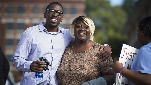 After 23 years in prison for a crime he did not commit, Lamonte McIntyre, left, walked out of the courthouse in Kansas City, Kan., with his mother, Rosie McIntyre, a free man. McIntyre, 41, was serving two life sentences for the 1994 murders of Doniel Quinn, 21, and his cousin, Donald Ewing, 34. They were shot in broad daylight as they sat in a car in a drug-infested neighborhood in Kansas City, Kan. (Tammy Ljungblad /The Kansas City Star via AP)