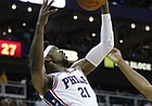 Philadelphia 76ers center Joel Embiid (21) pulls in a rebound in front of Miami Heat forward Jordan Mickey (25) during the first quarter of an NBA preseason basketball game in Kansas City, Mo., Friday, Oct. 13, 2017. (AP Photo/Colin E. Braley)