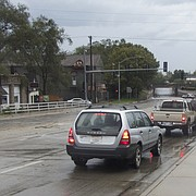 Traffic backs up at about 4:30 p.m. Saturday on North Second Street as Lawrence police block traffic on the street under the Union Pacific Railroad overpass. Jennifer Prieto, a meteorologist with the National Weather Service in Topeka, said about a half-inch of rain fell in less than an hour at Lawrence Municipal Airport as a stormfront blew through the city. The storm also packed 50-75 mph winds, downing multiple tree limbs and power lines in Lawrence, Prieto said.