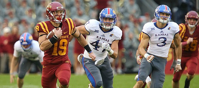 Kansas special teams players Keith Loneker Jr. (47) and Chase Harrell (3) trail behind Iowa State punt returner Trever Ryen (19) as he takes off up the field for a touchdown during the second quarter on Saturday, Oct. 14, 2017 at Jack Trice Stadium in Ames, Iowa.