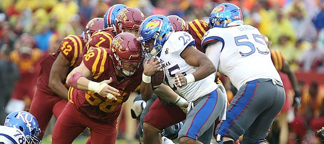 Kansas running back Dom Williams (25) is hit by Iowa State defensive end J.D. Waggoner (58) on a run during the second quarter on Saturday, Oct. 14, 2017 at Jack Trice Stadium in Ames, Iowa.