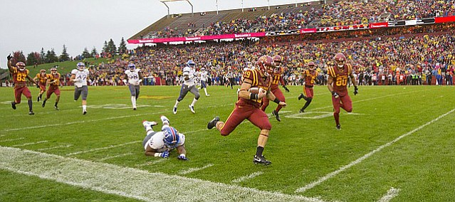 Kansas special teams player Chris Hughes (76) is left in the wake of Iowa State punt returner Trever Ryen (19) who runs in a touchdown during the first quarter on Saturday, Oct. 14, 2017 at Jack Trice Stadium in Ames, Iowa.