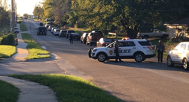 Lawrence police block off 27th Street just east of Haskell Avenue during a standoff with a man at a house who was reportedly armed with a gun, Monday, Oct. 16, 2017.
