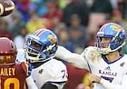 Kansas quarterback Peyton Bender (7) throws under pressure during the second quarter on Saturday, Oct. 14, 2017 at Jack Trice Stadium in Ames, Iowa.