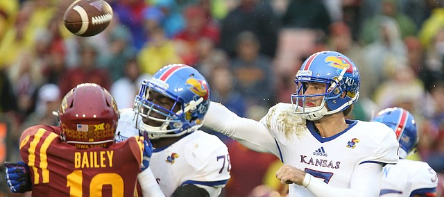 Kansas quarterback Peyton Bender (7) throws under pressure during the second quarter on Saturday, Oct. 14, 2017 at Jack Trice Stadium in Ames, Iowa.