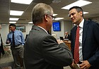 U.S. Rep. Kevin Yoder, right, R-Overland Park, talks with Kansas State Board of Education Member John Bacon, R-Olathe, following a state board meeting Tuesday.