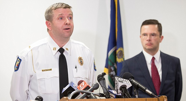 Lawrence Police Capt. Adam Heffley addresses media members Tuesday, Oct. 17, 2017 at the Lawrence Police Department's Investigations and Training Center, alongside chief assistant district attorney David Melton. Two arrests have been made in connection to an Oct. 1 shooting on Massachusetts Street that left three people dead.