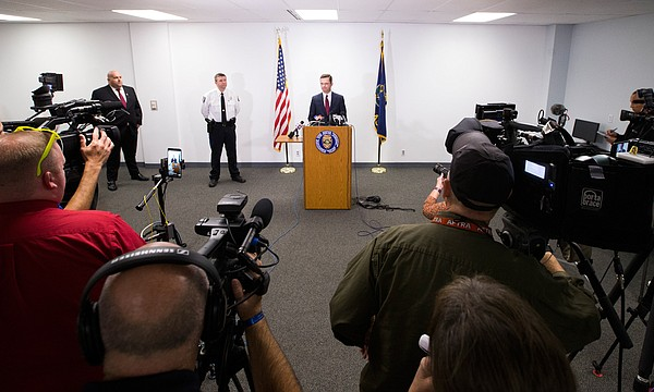 Douglas County Chief Assistant District Attorney David Melton addresses a gathering of media members next to Lawrence Police Capt. Adam Heffley and Officer Drew Fennelly, left, on Tuesday, Oct. 17, 2017 at the Lawrence Police Department's Investigations and Training Center, 4820 Bob Billings Parkway. The Lawrence Police Department announced that two arrests have been made in connection with an Oct. 1 shooting on Massachusetts Street that left three people dead.