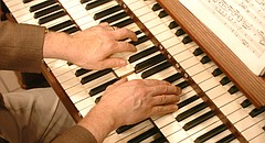 In this file photo from 2007, an organist plays at the University of Kansas' Bales Organ Recital Hall at the Lied Center.