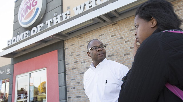 Burger King area director Anthony Robinson talks with Grace Porter, right, and other media members on Thursday, Oct. 19, 2017 outside the Lawrence Burger King location at 4671 Bauer Farm Drive. Robinson addressed a recent Burger King's action related to an employee complaint of racist Facebook posts made by a former hourly manager at the location. Robinson also added that the general manager, whose responsibility it was to immediately report the issue, was terminated.