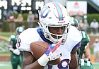 Kansas wide receiver Jeremiah Booker (88) pulls in a deep pass as he is dragged down during the fourth quarter on Saturday, Sept. 16, 2017 at Peden Stadium in Athens, Ohio.