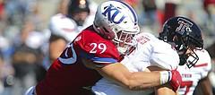Kansas linebacker Joe Dineen Jr. (29) stops Texas Tech quarterback McLane Carter (6) on a run during the fourth quarter on Saturday, Oct. 7, 2017 at Memorial Stadium.