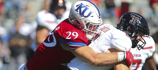 Kansas linebacker Joe Dineen Jr. (29) stops Texas Tech quarterback McLane Carter (6) on a run during the fourth quarter on Saturday, Oct. 7, 2017 at Memorial Stadium.
