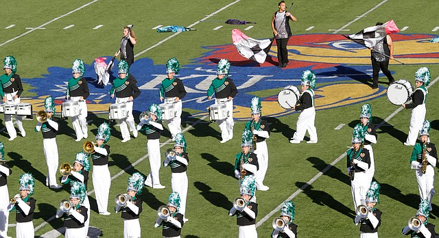 Members of the Lawrence Free State Marching Firebirds compete Saturday, Oct. 12, 2013, during the 22nd annual Heart of America Marching Band Festival at Memorial Stadium.