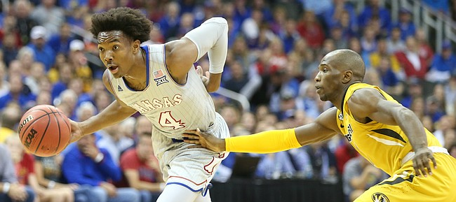 Kansas guard Devonte' Graham (4) gets around Missouri guard C.J. Roberts (0) during the first half of the Showdown for Relief exhibition, Sunday, Oct. 22, 2017 at Sprint Center in Kansas City, Missouri.