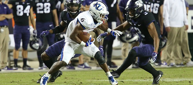 Kansas wide receiver Quan Hampton (6) can't escape two TCU defenders during the fourth quarter, Saturday, Oct. 21, 2017 at Amon G. Carter Stadium in Fort Worth.