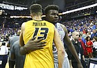 Kansas center Udoka Azubuike (35) hugs Missouri forward Michael Porter Jr. (13) following the Jayhawks' 93-87 win during the Showdown for Relief exhibition, Sunday, Oct. 22, 2017 at Sprint Center in Kansas City, Missouri.