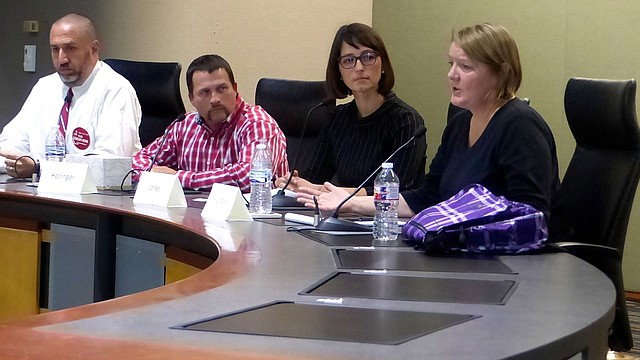 """Lawrence school board candidate Gretchen Lister answers a question while three other candidates (from left), Ronald """"G.R."""" Gordon-Ross, James Alan Hollinger and Kelly Jones listen during a two-hour forum the Voter Education Coalition sponsored Sunday at Lawrence City Hall."""